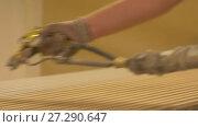 Купить «worker hand sprays polish to mdf planks», видеоролик № 27290647, снято 17 ноября 2017 г. (c) Syda Productions / Фотобанк Лори