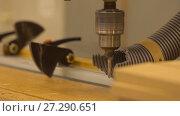 Купить «drill press machine and wooden board at workshop», видеоролик № 27290651, снято 17 ноября 2017 г. (c) Syda Productions / Фотобанк Лори