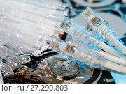 Купить «Server hard disks, illuminated optical fiber with blurred lights», фото № 27290803, снято 22 июля 2018 г. (c) Mikhail Starodubov / Фотобанк Лори