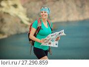 Купить «Girl tourist with a backpack on the background of mountains», фото № 27290859, снято 4 августа 2015 г. (c) Наталья Давыдова / Фотобанк Лори
