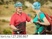 Купить «Portrait male  and women cyclist with a mountain bike», фото № 27290867, снято 4 августа 2015 г. (c) Наталья Давыдова / Фотобанк Лори