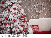 Купить «Snowy Christmas tree with red gifts decoration and comfy sofa before bokeh lights on the wall in holiday room interior home», фото № 27294543, снято 17 июля 2019 г. (c) Photobeauty / Фотобанк Лори