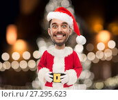 Купить «man in santa claus costume over christmas lights», фото № 27295623, снято 15 января 2016 г. (c) Syda Productions / Фотобанк Лори