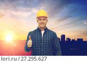 Купить «male builder in yellow hard hat showing thumbs up», фото № 27295627, снято 7 марта 2015 г. (c) Syda Productions / Фотобанк Лори