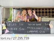 Купить «happy couple of sellers waving hands at food truck», фото № 27295739, снято 1 августа 2017 г. (c) Syda Productions / Фотобанк Лори