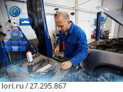 Купить «mechanic man with wrench repairing car at workshop», фото № 27295867, снято 1 июля 2016 г. (c) Syda Productions / Фотобанк Лори