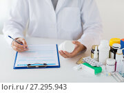 doctor with medicines and clipboard at hospital. Стоковое фото, фотограф Syda Productions / Фотобанк Лори