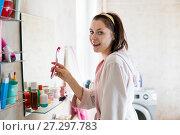 woman in the bathroom brushes teeth. Стоковое фото, фотограф Типляшина Евгения / Фотобанк Лори