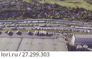 Купить «Aerial view of Manufacture of reinforced concrete structures», видеоролик № 27299303, снято 14 декабря 2017 г. (c) Илья Насакин / Фотобанк Лори