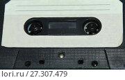 Купить «vintage orange audio cassette tape with a blank label», видеоролик № 27307479, снято 12 апреля 2017 г. (c) Курганов Александр / Фотобанк Лори