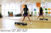 Купить «Beautiful female on the step board during exercise.», видеоролик № 27307527, снято 4 октября 2017 г. (c) Курганов Александр / Фотобанк Лори