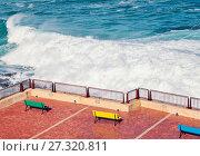 Купить «Empty benches along the coastline», фото № 27320811, снято 22 декабря 2017 г. (c) Kira_Yan / Фотобанк Лори