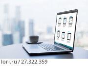 Купить «laptop with smartphone interface design on screen», фото № 27322359, снято 17 февраля 2015 г. (c) Syda Productions / Фотобанк Лори