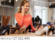 Купить «young woman calling on smartphone at shoe store», фото № 27322443, снято 22 сентября 2017 г. (c) Syda Productions / Фотобанк Лори