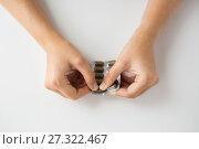 Купить «woman hands opening pack of medicine pills», фото № 27322467, снято 27 сентября 2017 г. (c) Syda Productions / Фотобанк Лори