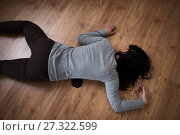 Купить «dead woman body in blood on floor at crime scene», фото № 27322599, снято 5 мая 2017 г. (c) Syda Productions / Фотобанк Лори