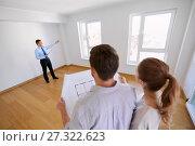 Купить «realtor showing new home to couple with blueprint», фото № 27322623, снято 4 июня 2017 г. (c) Syda Productions / Фотобанк Лори