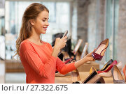 Купить «woman taking photo by smartphone at shoe store», фото № 27322675, снято 22 сентября 2017 г. (c) Syda Productions / Фотобанк Лори