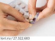 Купить «woman hands opening pack of medicine pills», фото № 27322683, снято 27 сентября 2017 г. (c) Syda Productions / Фотобанк Лори
