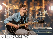 Купить «musician playing guitar at studio or music concert», фото № 27322767, снято 18 августа 2016 г. (c) Syda Productions / Фотобанк Лори