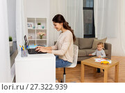 Купить «happy mother with baby and laptop working at home», фото № 27322939, снято 1 декабря 2017 г. (c) Syda Productions / Фотобанк Лори