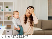 Купить «tired mother with baby boy at home», фото № 27322947, снято 1 декабря 2017 г. (c) Syda Productions / Фотобанк Лори