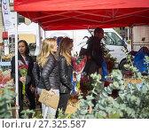 Купить «Shoppers buy flowers in the Union Square Greenmarket in New York on Saturday, November 4, 2017. (© Richard B. Levine).», фото № 27325587, снято 4 ноября 2017 г. (c) age Fotostock / Фотобанк Лори