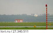 Купить «Airplane landing at rainy weather», видеоролик № 27340511, снято 24 июля 2017 г. (c) Игорь Жоров / Фотобанк Лори