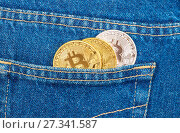 Купить «Coins of Cryptocurrency sticking out of the back jeans pocket. Business concept of digital money», фото № 27341587, снято 11 декабря 2017 г. (c) FotograFF / Фотобанк Лори