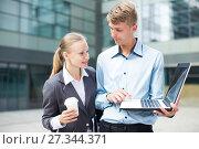 Купить «Couple professionals are examinating project on laptop», фото № 27344371, снято 15 июля 2017 г. (c) Яков Филимонов / Фотобанк Лори
