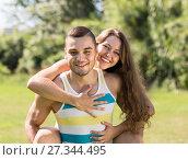 Купить «Loving couple in the park», фото № 27344495, снято 5 июля 2014 г. (c) Яков Филимонов / Фотобанк Лори