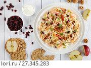 Купить «Coleslaw salad on a white plate», фото № 27345283, снято 30 декабря 2017 г. (c) Oksana Zh / Фотобанк Лори