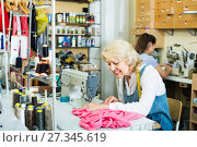 Купить «Two smiling women tailors different ages working with sewing machines», фото № 27345619, снято 4 декабря 2018 г. (c) Яков Филимонов / Фотобанк Лори