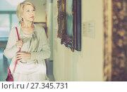 Купить «Female visitor looking at artwork painting in the museum indoors», фото № 27345731, снято 7 октября 2017 г. (c) Яков Филимонов / Фотобанк Лори