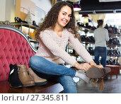 Купить «Young woman in a shoe store», фото № 27345811, снято 8 июля 2020 г. (c) Яков Филимонов / Фотобанк Лори