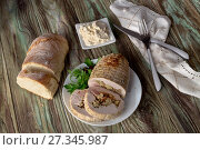 Roll of chicken fillet with stuffing edible chestnuts, bacon, cheese and spices is in a plate, on a wooden table close-up (Greek cuisine) Стоковое фото, фотограф Татьяна Ляпи / Фотобанк Лори