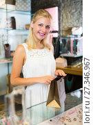 Купить «girl customer in bijouterie shop», фото № 27346967, снято 26 марта 2019 г. (c) Яков Филимонов / Фотобанк Лори