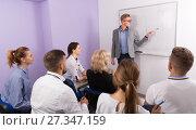 Купить «Medical male lecturer answering near whiteboard», фото № 27347159, снято 5 октября 2017 г. (c) Яков Филимонов / Фотобанк Лори