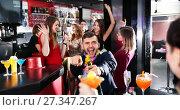 Купить «Cheerful guy expressively dancing partying in bar», фото № 27347267, снято 29 ноября 2017 г. (c) Яков Филимонов / Фотобанк Лори