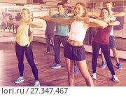 Купить «Smiling beginner dancers learning zumba elements», фото № 27347467, снято 19 ноября 2019 г. (c) Яков Филимонов / Фотобанк Лори
