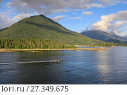 Купить «Forested mountains and small boat, from Sitka Sound, rare evening sun, summer, Sitka, Northern Panhandle, Southeast Alaska, United States of America, North America», фото № 27349675, снято 2 сентября 2017 г. (c) age Fotostock / Фотобанк Лори