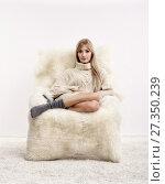 Купить «Blonde woman on furry arm-chair», фото № 27350239, снято 8 октября 2017 г. (c) Serg Zastavkin / Фотобанк Лори