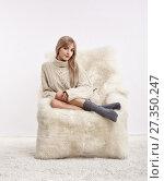 Купить «Blonde woman on furry arm-chair», фото № 27350247, снято 8 октября 2017 г. (c) Serg Zastavkin / Фотобанк Лори