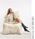 Купить «Blonde woman on furry arm-chair», фото № 27350251, снято 8 октября 2017 г. (c) Serg Zastavkin / Фотобанк Лори