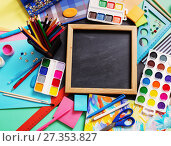 Купить «School stationery on background blackboard», фото № 27353827, снято 25 декабря 2017 г. (c) Майя Крученкова / Фотобанк Лори