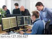 Купить «Startup business, software developer working on desktop computer.», фото № 27356627, снято 2 октября 2017 г. (c) Matej Kastelic / Фотобанк Лори