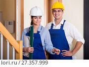 Купить «Professional maintenance crew of two specialists indoors», фото № 27357999, снято 12 ноября 2019 г. (c) Яков Филимонов / Фотобанк Лори