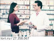 Купить «pharmacist serving woman in pharmacy», фото № 27358067, снято 18 июля 2018 г. (c) Яков Филимонов / Фотобанк Лори
