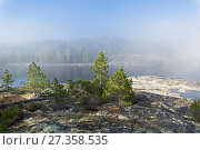 Купить «Редкий погодный феномен - в солнечный день облако лежит на поверхности озера. Ладожские шхеры, Карелия. Начало июня.», фото № 27358535, снято 6 июня 2017 г. (c) Сергей Рыбин / Фотобанк Лори