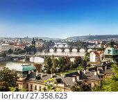Купить «Вид сверху на Прагу, мосты, реку Влтаву ранним утром, Чехия», фото № 27358623, снято 10 сентября 2014 г. (c) Наталья Волкова / Фотобанк Лори